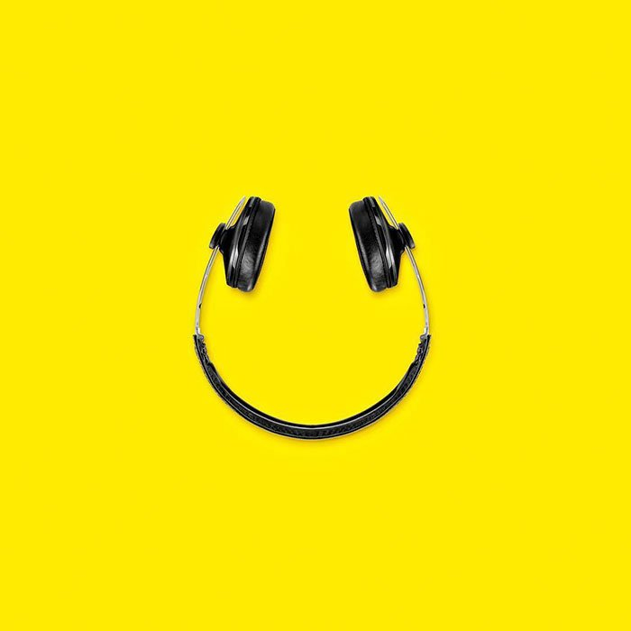 Consumerism culture mocked by Tony Futura headphones smiley