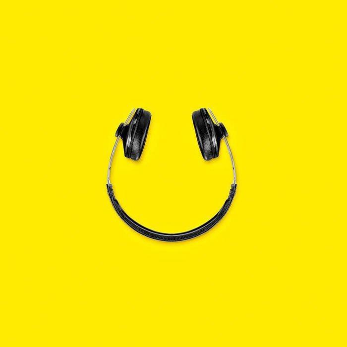 Consumerism culture mocked by Tony Futura headphones smiley