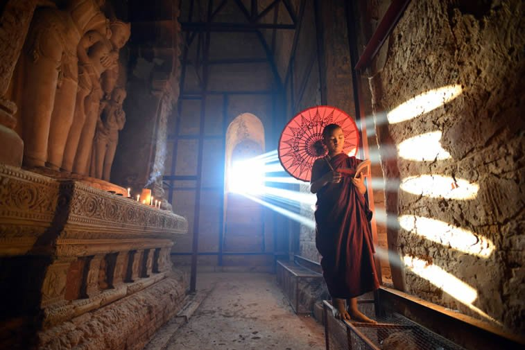 young monk at bagan myanmar indoor sunrays