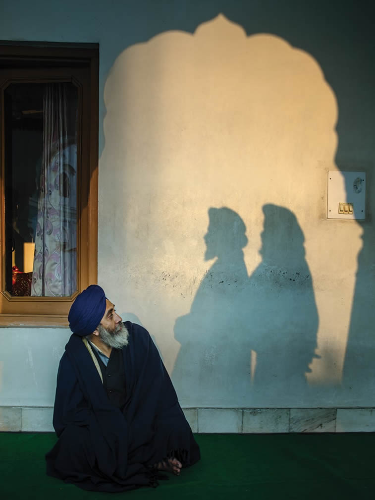a man looking towards two shadows amritsar punjab