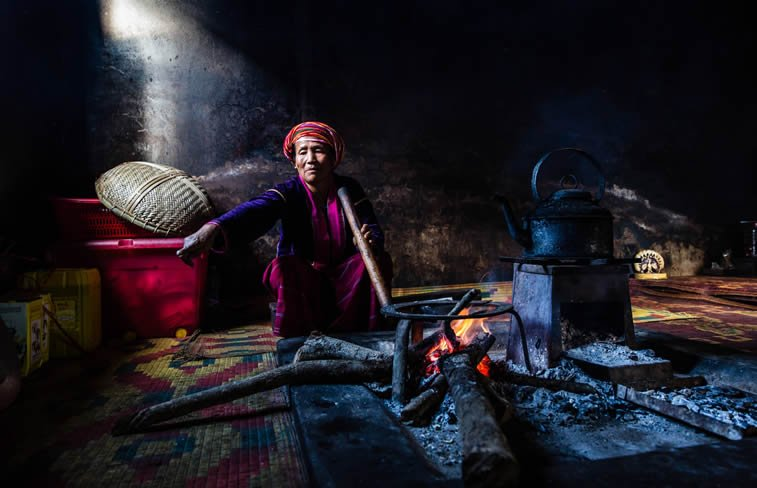 woman cooking in house of palaung tribal village myanmar