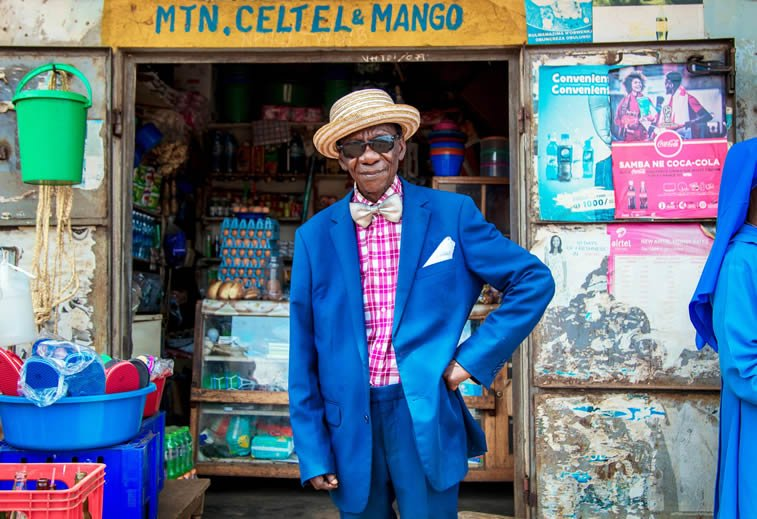 portrait of Henry Chiyumba in Uganda colorful outfit funky style 91-year old man