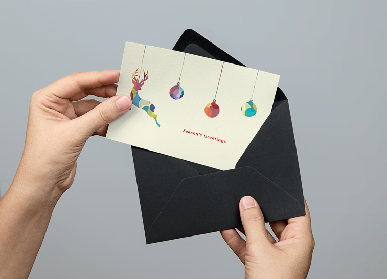 christmas card with envelope reindeer illustrated