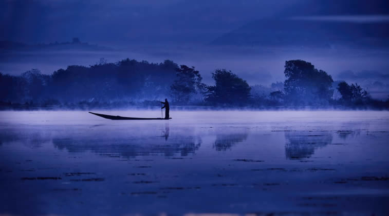 The blue light of a winter's dawn on Tharzi pond in Myanmar