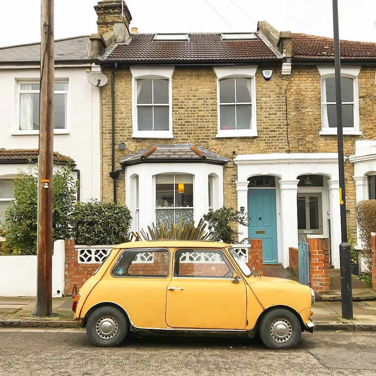 old mini morris in front of the house