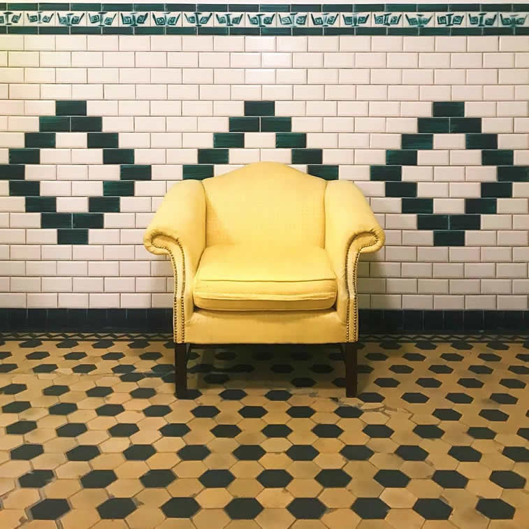 yellow arm chair on tiles