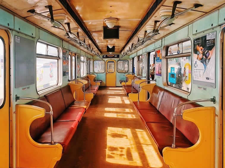 inside the metro train yellow red interior