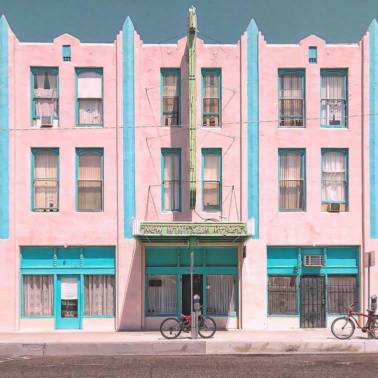 pink blue facade building bycicles