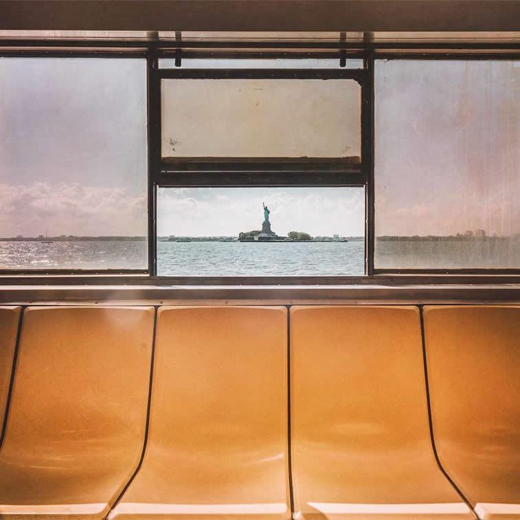 empty seats on boat statue of liberty new york hudnson river