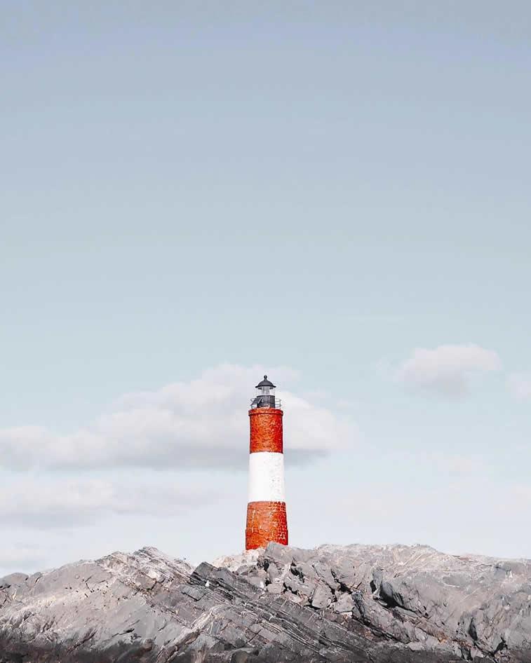 red white lighthouse rocks